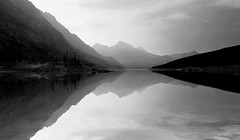 Medicine Lake in shades of grey during forest fire smog (Red Not Rab) Tags: monochrome landscape sky lake shadows reflections calm mountains medicinelake jaspernationalpark canada