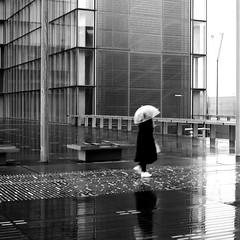 As a shade (pascalcolin1) Tags: paris13 bnf femme woman pluie rain reflets reflection parapluie umbrella carré square ombre shadow photoderue streetview urbanarte noiretblanc blackandwhite photopascalcolin 50mm canon50mm canon