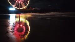 Wheel (lotosleo) Tags: light color pier wheel ocean night outdoor landscape reflection atlanticcity nj beach impression steelpier