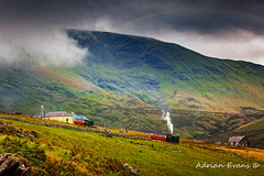 Steam Trains To The Summit (Adrian Evans Photography) Tags: track welshlandscape snowdonia landscape snowdonianationalpark welshmountain carriage loco northwales snowdonmountainrailway locomotive grass countryside llanberis clouds rail wales painterly outdoor rainbow steam uk adrianevans train british sky railway snowdon narrowgauge steamengine mountain canon 5dmk2