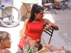The Stare.... (markwilkins64) Tags: greece corfu corfutown street streetphotography candid candidportraits cafe bar reddress bicycle gears glasses sunglasses drinks glare stare tension sony attractive women streetscene sunshine shade holiday markwilkins summer red