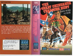 "Seoul Korea vintage VHS cover art for cult spaghetti western ""The Great Chihuahua Treasure Hunt"" - ""Skin and Swindle"" (moreska) Tags: seoul korea vintage vhs cover art retro spaghetti western seminude bare exposed adventure swindlers mexico tonino ricci comedy hangul graphics fonts videocassette homeentertainment massmedia disappearing analogue logos collectibles archive museum rok asia"