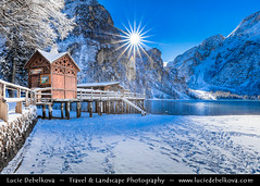 Italy - Alps - Dolomites - Lake Braies under fresh cover of snow with sun star (© Lucie Debelkova / www.luciedebelkova.com) Tags: pragser pragserwildsee lakeprags braies lake lakebraies lagodibraies dolomites dolomiti provinceofsouth tyrolsouth tyrolalpsalpineitalyitalianitaliaitalian republicrepublic italyrepubblica italianasouth europecountryeuropeeuropean unioneuitalian peninsula italie world exploration trip vacation holiday place destination location journey tour touring tourism tourist travel traveling visit visiting sight sightseeing wonderful fantastic awesome stunning beautiful breathtaking incredible lovely nice best perfect landscape nature mountains valley wwwluciedebelkovacom cloud building village mountain water waterscape shore snow winter white