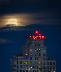 Beating back the Clouds (ihikesandiego) Tags: downtown san diego clouds full moon rising el cortez building