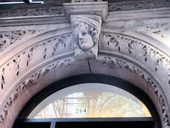 Wistful Gargoyle Face Above Doorway 4801 (Brechtbug) Tags: wistful gargoyle face above doorway building facade 25th street between 7th 8th avenues brownstone entrance nyc 11122018 new york city midtown manhattan 2018 gargoyles portraits monster portrait monsters creature faces spooky art architecture sculpture keystone mask brownstones brown stone