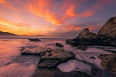 Viento sur en Azkorri (Caramad) Tags: fuego mar paisvasco landscape sunset rojo azkorri bizkaia clouds agua longexposure getxo beach puestadesol luz vientosur color marcantábrico seascape olas sea rocks playa