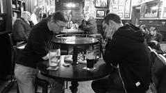 Beer Chess 01 (byronv2) Tags: beer chess game playing table board chessboard pint ale pub bennetts morningside edinburgh edimbourg scotland blackandwhite blackwhite bw monochrome peoplewatching candid street man bar drink drinking