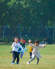 Jump2Live Christmas Party 164 (ArdieBeaPhotography) Tags: park public children kindergarten preteen young child kids girl boy elementary primary middleschool picnic christmas celebration party play class family son daughter grass trees group parent teacher jump run game winter father mother cute woman man city pink yellow green blue blow bubbles detergent floating toy plane airplane model throw