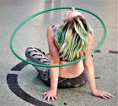 NOSEPLAY (Rob Patzke) Tags: hoop hula green lumix lx100 girl hair street nose twirl sitting spin performer