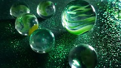 Green marbles  / Canicas verdes. (Marina Is) Tags: macromondays hmm canicas green verde marbles