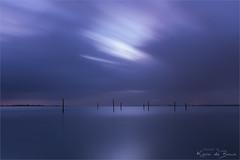 Moody! (karindebruin) Tags: haringvliet hellevoetsluis nederland thenetherlands voorneputten zonsopkomst zuidholland clouds fishingpoles sunrise visstokken water wolken