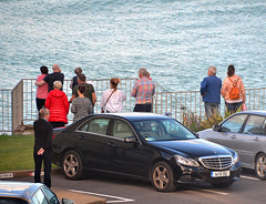 Watching the Rescue (Owen J Fitzpatrick) Tags: ojf people photography nikon fitzpatrick owen pretty pavement chasing d3100 ireland editorial use only ojfitzpatrick eire 115 republic city tamron joe unposed natural attractive beauty beautiful j along photoshoot street 2018 dslr digital sikorsky rescue red dalkey sky dublin sea mercedes merc car automobile railing water bay watch carpark watching onlookers witness irish