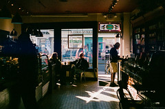Afternoon Cup (GPhace) Tags: 35mm coffee fall fuji fujifilm longisland minoltax700 nyc slr superia1600 afternoon goldenhour sunlight windowseat filmphotography