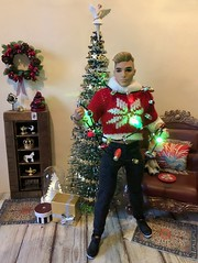 Tangled in Lights (MaxxieJames) Tags: bastian hunter doll mattel barbie ken christmas lights tree decorations diorama dolls collector fashionista
