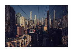 emerging from the canyon (Nico Geerlings) Tags: rooseveltislandtramway midtown manhattan ny nyc usa newyorkcity ngimages nicogeerlings nicogeerlingsphotography skyline skyscrapers urban reflection sunlight contrast fujifilmxt2 xf14mm