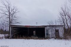 The Grey Door (gabi-h) Tags: shed grey door snow dilapidated gabih princeedwardcounty winter trees ontario lonely grass gloomy darkday windows doors