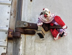 Damn lock...won't budge! (Twila1313) Tags: clown clowndoll doll lock door building breakin robbery criminal naughty badclown unlock padlock sonya7ii minoltamd50mmf2