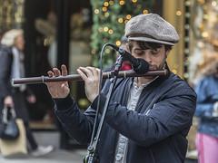 Phil the fluter (Frank Fullard) Tags: frankfullard fullard candid street portrait music flute busker streetmusician cap flautish irish ireland graftonstreet dublin beard color colour percyfrench