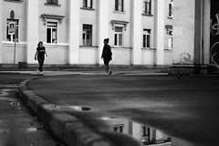 a russian summer [5/6] (Andrew.King) Tags: street photography low vantage point perspective water reflection building people windows grafitti pigeon signs road crossing blackandwhite black white contrast monochrome