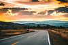 A Road to Better Days. (miss.interpretations) Tags: roads bend life lifejourney journey asphalt street pavement prairie meadow mountains sunset hills layers glow pink orange warm drive raodtrip car skies clouds canon6dmarkii