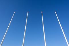 Four flagstaffs (Jan van der Wolf) Tags: map190111v four 4 vier vlaggenmast flagstaffs poles palen symmetry symmetric symmetrie simple simpel minimalism minimalistic minimalisme minimal minimlistic sky blue
