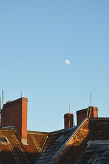 a cold and sunny afternoon in winter (ericgrhs) Tags: moon mond sky himmel berlin dach roof chimney schornstein bluesky afternoon backstein bricks building house rooftop
