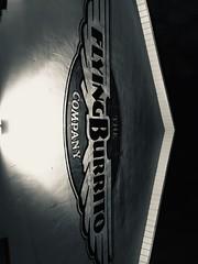 Upwards and onwards (noitalsnarT_nI_tsoL) Tags: yummy font letters wings logo food flyingburrito burrito lit light bw blackandwhite