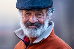 Alhamad [Stranger# 6] (Vijay Britto Photography) Tags: beard cap nikon tamron d750 100strangers strangers portrait naturallight outdoorportraits smile syrian doctor surgeon