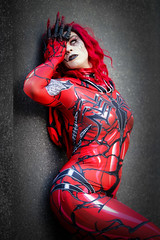 Carnage cosplayer at ExCeL London's MCM Comic Con, October 2018 (Gordon.A) Tags: london docklands excel excellondonexhibitioncentre mcm moviecomicmedia comicbookconvention comiccon con convention mcm2018 creative red costume makeup culture subculture style marvel marvelcomics venom carnage cosplay cosplayer cosplayphotography festival event eventphotography model lady woman face pose posed posing wall vignette outdoor outdoors outside amateur naturallight portrait portraitphotography colour colours color digital canon eos 750d sigma sigma50100mmf18dc
