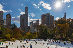 A Classic Central Park Scene (sarahOphoto) Tags: 2018 6d america apple autumn big canon fall new november states united usa york wollman rink icerink ice skating skate iceskate skyscrapers central park sun blue sky landscape urban trees buildings travel tourist nyc
