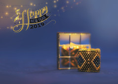 happy new year 2019 (rockinmonique) Tags: happynewyear tiny mini beads mirror reflections giftfromadearfriend gold blue light bokeh cubeis3cmby3cm reflection moniquewphotography canon canont6s tamron tamron45mm copyright2018moniquewphotography