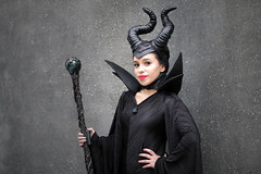 Maleficent cosplayer at ExCeL London's MCM Comic Con, October 2018 (Gordon.A) Tags: london docklands excel excellondonexhibitioncentre mcm moviecomicmedia comiccon con convention mcm2018 october 2018 creative black costume horns staff style culture maleficent sleepingbeauty walt disney character cosplay cosplayer cosplayphotography festival event eventphotography pretty lady woman face people pose posed posing outdoor outdoors outside wall day daylight naturallight portrait portraitphotography digital canon eos 750d sigma sigma50100mmf18dc