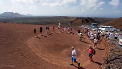 Volcano show (piotr_szymanek) Tags: lanzariote landscape mountains volcano soil lava people sky red 1k