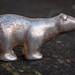 A tiny silver polar bear