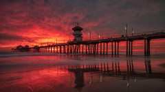 California Sky Fire (Bryan the Roving Vagabond) Tags: pier sky ocean sea seaside sunset clouds cloud longexposure water sand beach oc orangecounty california socal ca hunting huntingtonbeach surfcityusa ticketcityusa explore landscape seascape reflection holidaydecorations pacific dusk