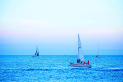 Will you take me with you? (Fnikos) Tags: sea water mar mare blue azul azzurro serene clear bay seascape sky skyline sport boat sailboat people outdoor