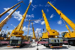 Mobile construction cranes with yellow telescopic arms and big tower cranes in sunny day with white clouds and deep blue sky on background, heavy industry (kavinprasath) Tags: crane construction tower mobile jib support hook lifting telescopic arm yellow truck bodywork heavy industry build carry raise move pneumatic piston technology machine equipment steel cord iron metal oversize engineering work job service help many large high development urban project tall housing activity mechanism occupation sunny white cloud blue sky russianfederation