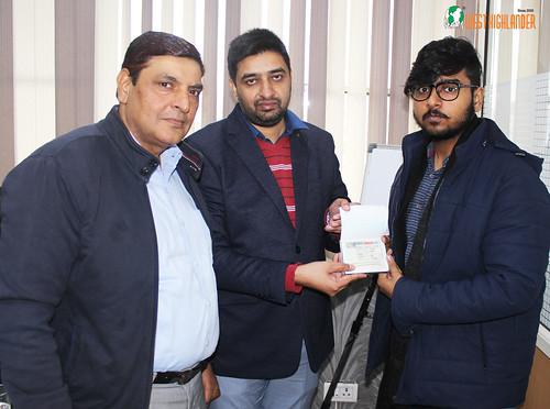 Mr. Gurvinder Kang (Director of West Highlander) handing over Canada Student Visa to Abhinav