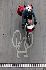The Cyclist (Isengardt) Tags: bicycle fahrrad taschen bags rampe ramp sign zeichen weg fahrradweg tores reifen strase street strasenfotografie streetphotography helm helmut farbe color bewegungsunschärfe motionblur esslingen badenwürttemberg deutschland germany europe