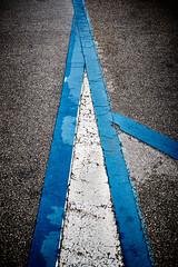 Capital A (iamunclefester) Tags: vacation holiday croatia krk otokkrk street tar road marking roadmarking roadpainting painting a parking parkinglot blue white texture capital wet rainy