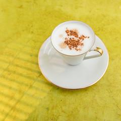 Cappuccino (annick vanderschelden) Tags: cup saucer milk coffee espresso cappuccino italian gold yellow lighteffect hot italy brewed coffeedrink beverage liquid fluid steamed foam bubbles cream flavoring barista blend topped cinnamonpowder belgium