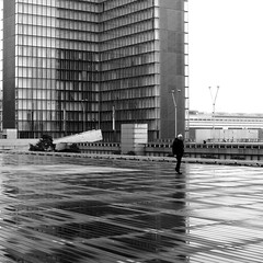 In the dark side (pascalcolin1) Tags: paris13 bnf homme man pluie rain reflets reflection photoderue streetview urbanarte noiretblanc blackandwhite photopascalcolin 50mm canon50mm canon