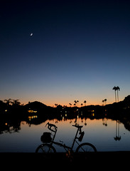 Desert Oasis (Shu-Sin) Tags: desert night crescent moon city scape landscape palm tree sunset bicycle bike raleigh twenty modification mod 20in touring randonneur randonneuse sky water reflection travel