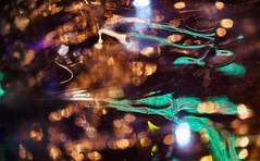 Night Ripples (jaxxon) Tags: 2018 d610 nikond610 jaxxon jacksoncarson nikon nikkor lens nikon105mmf28gvrmicro nikkor105mmf28gvrmicro 105mmf28gvrmicro 105mmf28 105mm macro micro prime fixed pro abstract abstraction night lights ripple ripples distorted distortion reflection diffusion bokeh plastic surface warp warped urban light teal orange amber green blue dark
