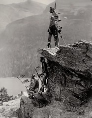 """""""The Eagle"""" by Roland W. Reed. Native Americans of the Blackfoot tribe in Glacier National Park, Montana (ca. 1913) (lhboudreau) Tags: nativeamericans nativeamerican americanindian vintagephoto vintagephotograph vintagephotography rolandreed monochrome blackandwhite blackwhite rolandwreed pictorialist focus lighting image outdoor outdoors reed indian photo antiquephoto water rock rocks people indians americanindians landscape river rocky cliff mountain mountainside indigenouspeople indigenous bw theeagle 1913 glaciernationalpark montana mountains mountainous blackfoottribe blackfeet blackfoot blackfeettribe beads feathers necklace walkingstick"""