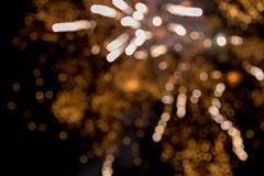 Fireworks photographed in the night sky on New Year's Eve with bokeh (verchmarco) Tags: holland niederlande zandvoort bloemendaal overveen provinznordholland nl christmas weihnachten abstract abstrakt desktop celebration feier insubstantial unwesentlich luminescence lumineszenz color farbe design blur verwischen decoration dekoration glisten glitzern dark dunkel art kunst bright hell party merry fröhlich illustration roundout runden gold focus fokus macromondays bar cielo colours harbour child interior sport farm camera