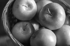 Dark Side Of The Apple (aaron_gould) Tags: apple fruit monochrome nikkor 50mm black white stem basket macro bokeh home art bw d7000