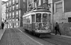 Street car (Manuel Goncalves) Tags: streetcar lisbon portugal kodaktmax400 nikonn90s nikkor28mm blackandwhite 35mmfilm tram road epsonv500scanner