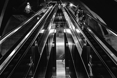 up it goes (Zesk MF) Tags: bw black white mono zesk cologne street candid rolltreppe x100f fuji