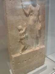 Stele woman and child.    CaixaForum, Madrid, June 2018 (d.kevan) Tags: exhibitions caixaforum ancientinstruments displaycabinets june2018 madrid spain exhibits musicians stele womanandchild dancers carving